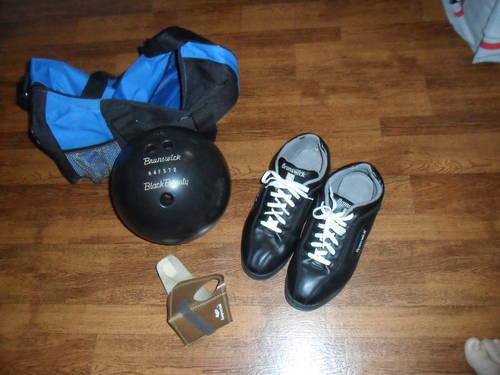 Brunswick Black Beauty bowling ball and a pair ,4 Duck pin ball