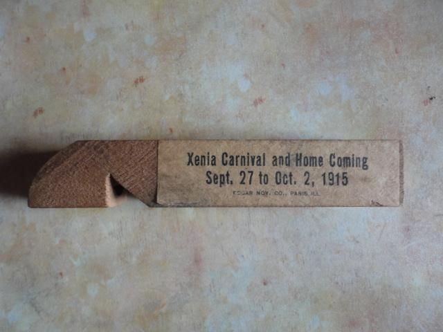 Wooden whistle with 1915 ads on it.