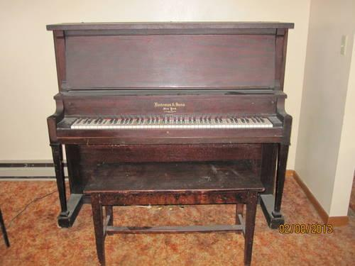 nice piano with bench- walnut color