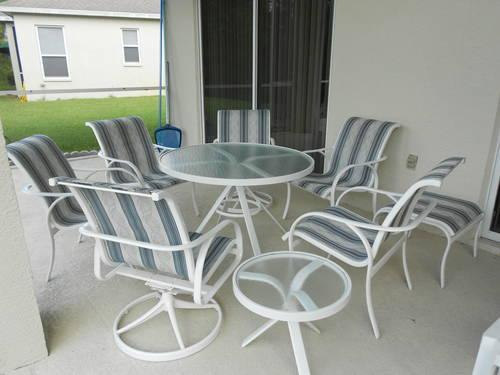 TROPITONE 9 PIECE PATIO SET 6 CHAIRS 2 TABLES AND AN OTTOMAN
