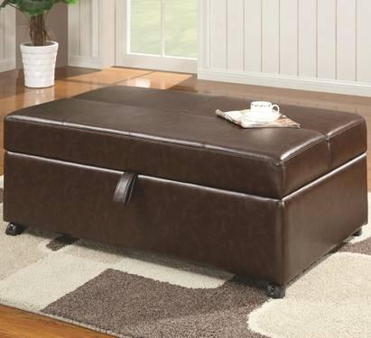 NIB! Brown faux leather ottoman that converts to a twin bed!