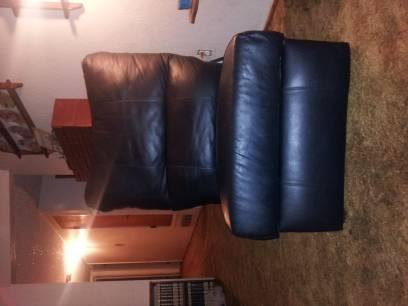 2 black leather reclining chairs