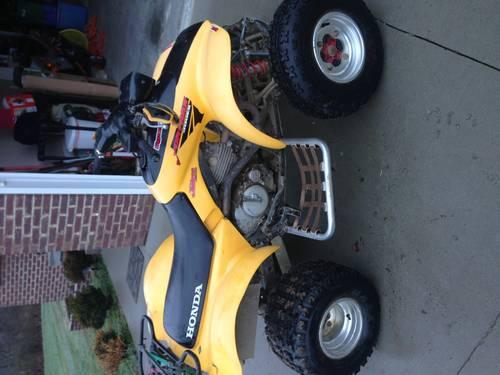 Yellow 2003 Honda Sportrax 300EX with reverse and custom accessories -
