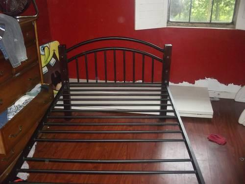 Twin bed/ Dark Cherry wood and metal